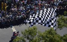 Argentinian fans gather during the 2014 Dakar Rally departure ceremony in Rosario, Argentina on January 4, 2014. The 2014 Dakar Rally will thunder through Argentina, Bolivia and Chile from January 5 to 18. Picture: AFP.
