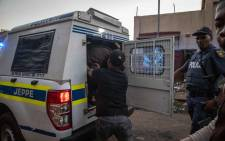 FILE: Suspects are loaded into a police van after being arrested for looting in Troyville, Johannesburg on 2 September 2019. Picture: Thomas Holder/EWN