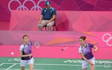 Kim Ha Na (L) and Jung Kyung Eun of South Korea playing a shot during their women's doubles badminton match against China's Wang Xiaoli and Yu Yang at the London 2012 Olympic Games. Picture: AFP.