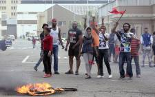 Foreign nationals gesture after clashes broke out between a group of locals and police in Durban on 14 April, 2015 in ongoing violence against foreign nationals in Durban, South Africa. Picture: AFP