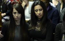 Reeva Steenkamp's friends Gina and Kim Myers in the Pretoria Magistrates Court where Oscar Pistorius appeared on 19 August 2013. Picture: AFP.