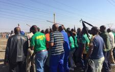 Three years later, miners carry sticks and umbrellas not knives and pangas, as the 16 August marks three years anniversary of the Marikana shooting. Picture: Gia Nicolaides/EWN.