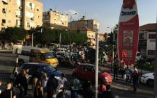 Onlookers gather after a stabbing incident near a bus station in the occupied West Bank. Picture: @IDFSpokesperson/Twitter