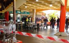 Police gather at the scene following a robbery at FNB Oriental Plaza in Fordsburg on 3 July 2015. @crimeairnetwork