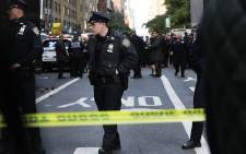 FILE: Police gather outside the Time Warner Center after an explosive device was sent to the CNN offices on 24 October 2018 in New York City. Picture: AFP
