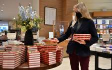 """A member of staff prepares a special display for JK Rowling's new children's novel """"The Christmas Pig"""" at the Waterstones Piccadilly bookshop in London on October 12, 2021. Picture: AFP."""