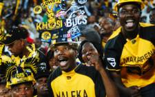 Kaizer Chiefs supporters celebrate a goal at Coca-Cola Park. Orlando Pirates won 2-1. Picture: EWN