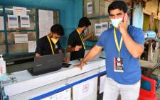 In this photograph taken on April 28, 2021, local resident Shanawaz Shaikh, who sold his SUV to raise funds in order to start a free service to provide oxygen cylinders to needy people amid the Covid-19 coronavirus pandemic, speaks on the phone at an oxygen distribution centre in a slum in Mumbai. As their government struggles to tackle the Covid-19 pandemic, young Indians have stepped into the breach, setting up apps to crowdsource aid, delivering key supplies and using social media to direct resources to people in need. Picture: Indranil Mukherjee / AFP