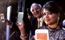 Ashok Chadha (2-R), President of Ringing Bells Pvt. Ltd., along with unidentified Ringing Bells official shows the 'Freedom 251' smartphone after its launch in New Delhi, India, 17 February 2016. Picture: EPA.