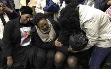 Relatives comfort Iyapha Yamile's mother (second right) after her child's killer, Odwa Nkololo, was sentenced at the Western Cape High Court on 28 August. Picture: Lauren Isaacs/EWN.