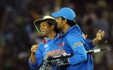 Sachin Tendulkar (L) and MS Dhoni celebrate after winning the second semi-final match of The ICC Cricket World Cup 2011 on 30 March. Picture: AFP