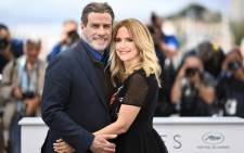 "In this file photo taken on 15 May 2018 US actor John Travolta (L) and his wife US actress Kelly Preston pose during a photocall for the film ""Gotti"" at the 71st edition of the Cannes Film Festival in Cannes, southern France. Kelly Preston, US actress and wife of US actor John Travolta, died after a battle with breast cancer at the age of 57, US media reported on 12 July 2020. Picture: AFP"