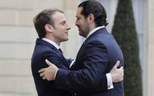 French President Emmanuel Macron (L) welcomes Lebanese Prime Minister Saad Hariri at the Elysee Presidential Palace on 18 November, 2017 in Paris. Picture: AFP