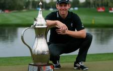 Stephen Gallacher of Scotland poses with his trophy after winning the 2014 Omega Dubai Desert Classic on February 2, 2014. AFP.