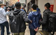 Ben Chung (second right) of a pro-democracy political group is arrested by police in the Central district after as many as 50 Hong Kong opposition figures were arrested in Hong Kong on 6 January 2021, under a new national security law. Picture: AFP.