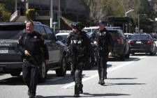 Police walk outside of the YouTube headquarters on 3 April, 2018 in San Bruno, California. Police are investigating an active shooter incident at YouTube headquarters that has left at least one person dead and several wounded. Picture: AFP