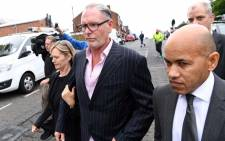 FILE: Former England footballer Paul Gascoigne (C) leaves Dudley Magistartes Court in Dudley, central England, on 19 September 2016. Picture: AFP