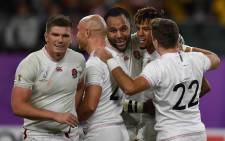 England's wing Anthony Watson (2nd R) is congratulated after scoring a try during the Japan 2019 Rugby World Cup quarter-final match between England and Australia at the Oita Stadium in Oita on 19 October 2019. Picture: AFP