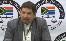 A YouTube screengrab of former late Cabinet minister Collins Chabane's spokesperson Brent Simons giving testimony at the Zondo commission of inquiry on 26 August 2019.