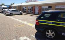 Salim Dawjee's business in Goodwood was raided by police and the Hawks on 5 December 2013. Picture: Rafiq Wagiet/EWN.