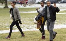US President Barack Obama and his daughters Malia (left) and Sasha. Picture: EPA.
