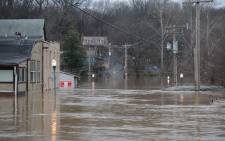 Water Street is seen fully submerged as the Meremac River rises into the town on December 30, 2015 in Fenton, Missouri. Picture: AFP
