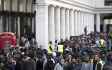 People queue outside the Apple Store to buy the iPhone 5 at Covent Garden in London on September 21, 2012. Picture: AFP.