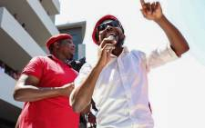 Floyd Shivambu and Mbuyiseni Ndlozi address EFF members outside the venue of the state capture inquiry on 17 November 2018. Picture: Abigail Javier/EWN