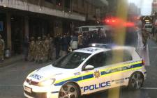 SA army and police raided on a buildings around Johannesburg CBD on 8 May 2015 as part of their operation to search for illegal goods, weapons and drugs. Picture: Nyasha Mharakurwa ‏@sirnyasha.