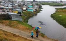 Shacks along Mew Way in Khayelitsha not spared,many residents scooping water out of their shacks. Picture: Siyabonga Sesant/EWN.