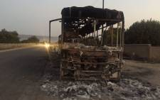 The burnt out Bapo Transport bus which was torched by protesting Marikana residents. Picture: Masa Kekana/EWN