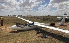 Paramedics attend to the scene of glider crash near New Tempe Airport in Bloemfontein. Picture: @_ArriveAlive/Twitter.