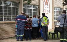 Parents, teachers and community members gather outside Hoërskool Driehoek in Vanderbijlpark where a structural collapse killed at least three children and injured over 20 others on 1 February 2019. Picture: Christa Eybers/EWN