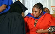 Correctional Services Minister Nosiviwe Mapisa-Nqakula and convicted murderer Dina Rodriguez during the ceremony for graduates who obtained an e-literacy certificate at Pollsmoor on 14 May 2012. Picture: Aletta Gardner/EWN