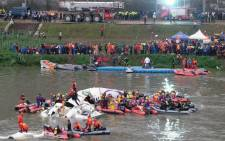 Rescue personnel search for passengers from the wreckage of a TransAsia ATR 72-600 turboprop plane that crash-landed into the Keelung river outside Taiwan's capital Taipei in New Taipei City on February 4, 2015. Picture: AFP.