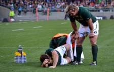 Springbok hooker Bismarck du Plessis is examined while his brother Jannie looks on after injuring himself in the opening minutes of the Rugby Championship game against Argentina in Cape Town on 18 August 2012. Picture: Aletta Gardner/EWN.