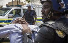 A student is detained by a public order police officer at the Cape Peninsula University of Technology. Picture: Thomas Holder/EWN.