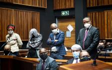 Sybil Ngcobo, Mmakgosi Mosupi, Valdis Romaano and Obakeng Mookeletsi appeared at the Palm Ridge Magistrates Court on 22 October 2020 on corruption charges linked to a R1.4 billion Gauteng Department of Health tender. Picture: Xanderleigh Dookey/EWN