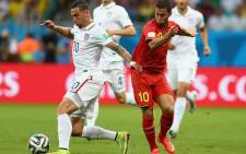 FILE: USA defender Geoff Cameron holds off Belgium midfielder Eden Hazard during their World Cup last-16 match. Picture: Facebook.