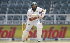Proteas batsman Hashim Amla keeps an eye on his shot. Picture: AFP
