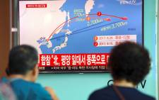 People watch a screen showing a graphic of a North Korean missile launch, at a railway station in Seoul, South Korea on September 15, 2017. Picture: AFP