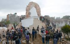 Nepalese rescue members and onlookers gather at the collapsed Darahara Tower in Kathmandu on April 25, 2015. A powerful 7.9 magnitude earthquake struck Nepal, causing massive damage in the capital Kathmandu with strong tremors felt across neighbouring countries. Picture: AFP.