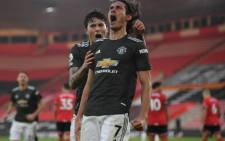 Manchester United striker Edinson Cavani (R) celebrates scoring their second goal with teammate Victor Lindelof during the English Premier League football match between Southampton and Manchester United at St Mary's Stadium in Southampton, southern England on 29 November 2020. Picture: AFP