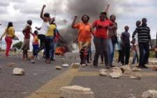 FILE: Protesters in Hebron blocked major roads with rocks and burned tyres during service delivery protests. Picture: Barry Bateman/EWN.