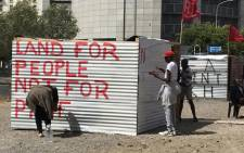 Social housing lobby group Reclaim The City occupies a piece of land on the Foreshore in Cape Town's CBD on 4 December 2018 in protest over the sale of the land. Picture: Kevin Brandt/EWN