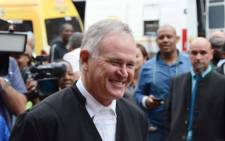 Barry Roux leaves High Court in Pretoria after the Oscar Pistorius murder trial was postponed on 28 March 2014. Picture: Rahima Essop/EWN.