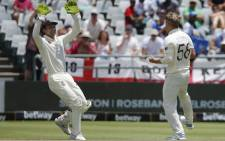 England's Sam Curran (R) celebrates with England's Jos Buttler (L) after the dismissal of South Africa's Pieter Malan during the fifth day of the second Test cricket match between South Africa and England at the Newlands stadium in Cape Town on 7 January 2020. Picture: AFP