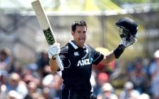 New Zealand's Ross Taylor celebrates his century during the third ODI cricket match between New Zealand and Sri Lanka at Saxton Field in Nelson on 8 January, 2019. Picture: AFP
