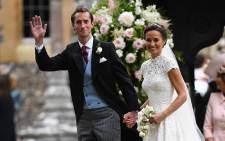 Pippa Middleton and her new husband James Matthews leave St Mark's Church in Englefield on 20 May 2017 following their wedding ceremony. Picture: AFP.