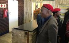 EFF leader Julius Malema seen with party's spokesperson Mbuyiseni Ndlozi at the Johannesburg Central Police Station. Picture: Thando Kubheka/EWN.